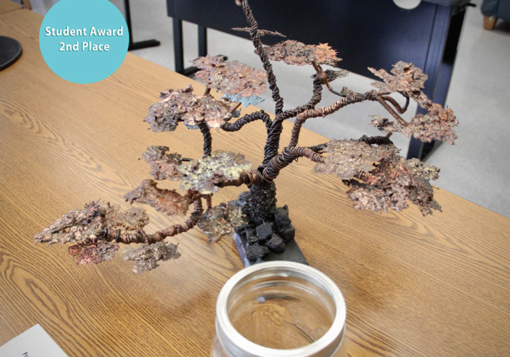 Photo of a small tree made out of repurposed materials